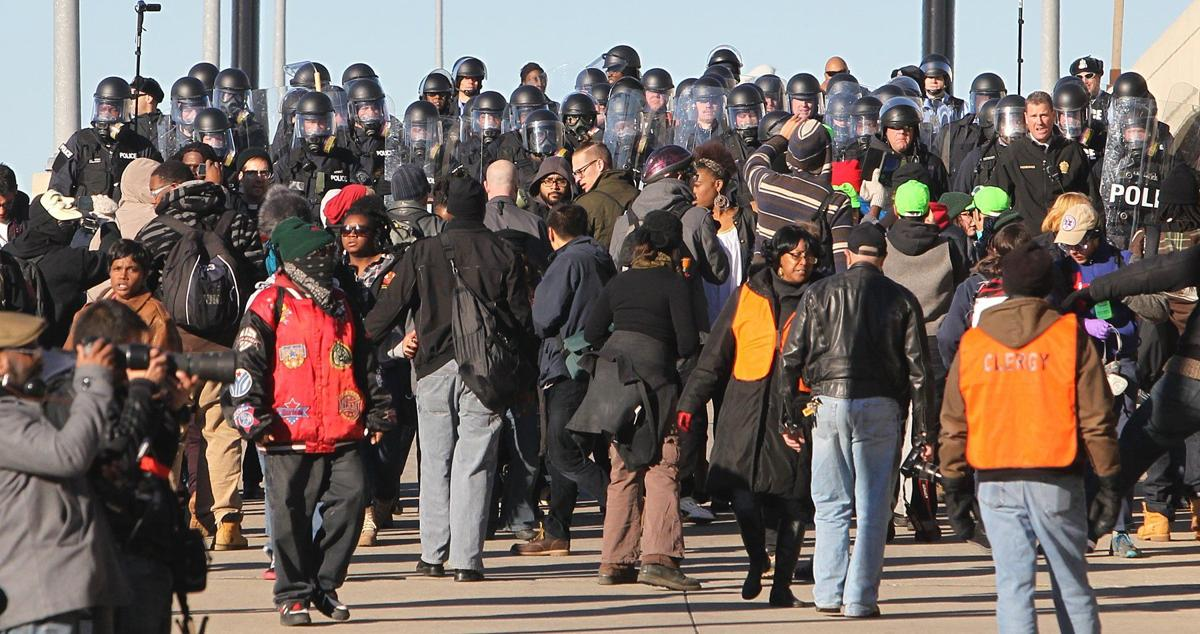 Protesters march around downtown St. Louis
