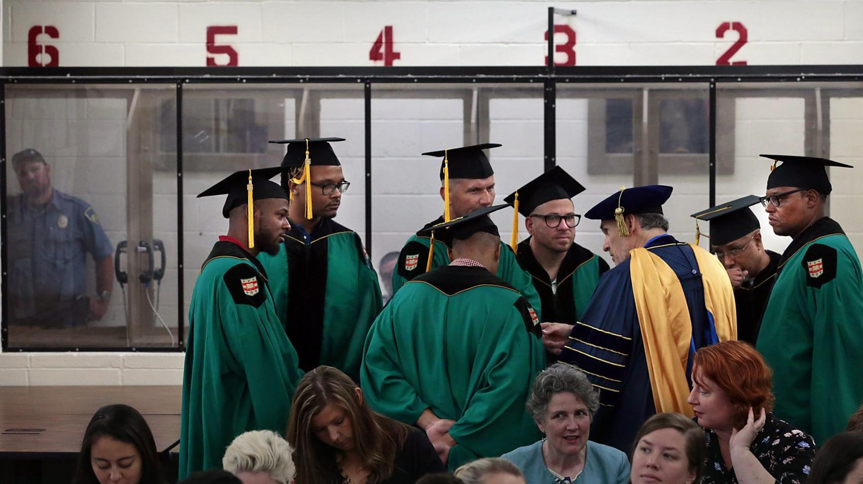 Graduates of Washington University's Prison Education Project speak with its director, Robert K. Henke, in front of the visitation bays at the Missouri Eastern Correctional Center in Pacific before ten inmates received associate degrees on Wednesday, May 22, 2019.