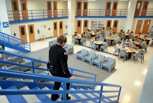 Corrections officer in pod at St. Louis County Jail
