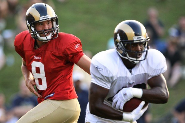 Sam Bradford hands off to St. Louis Rams' Jamie McCoy