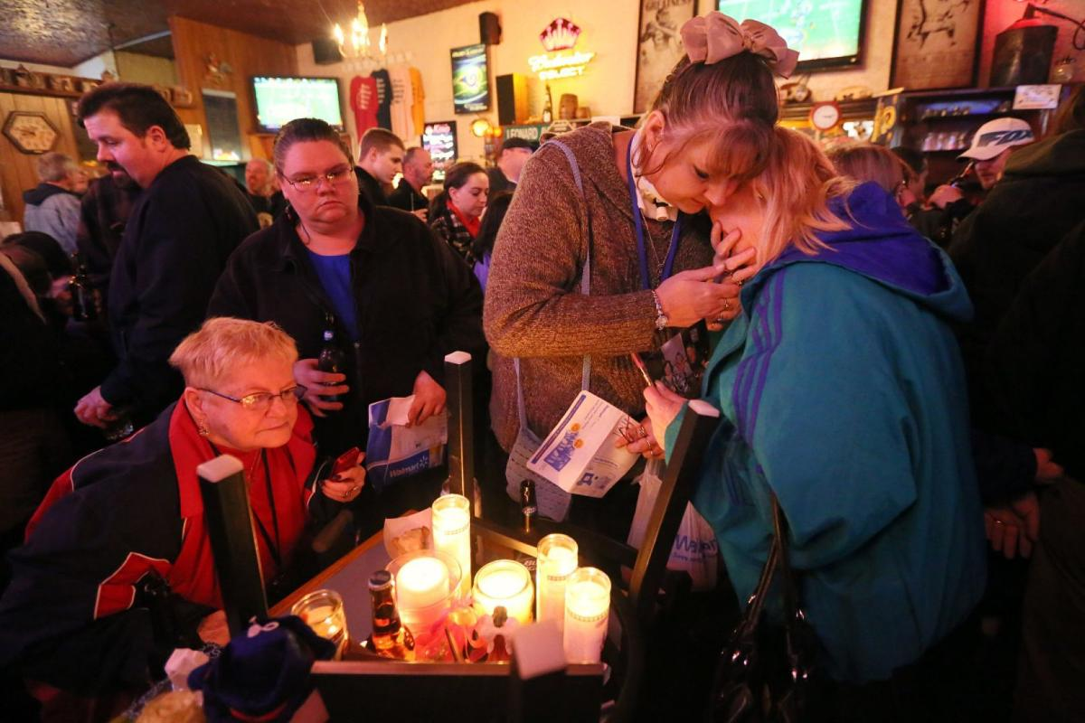 Vigil for victims of Pooh's Corner robbery