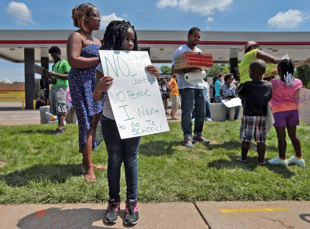 With classes canceled, student joins protest in Ferguson