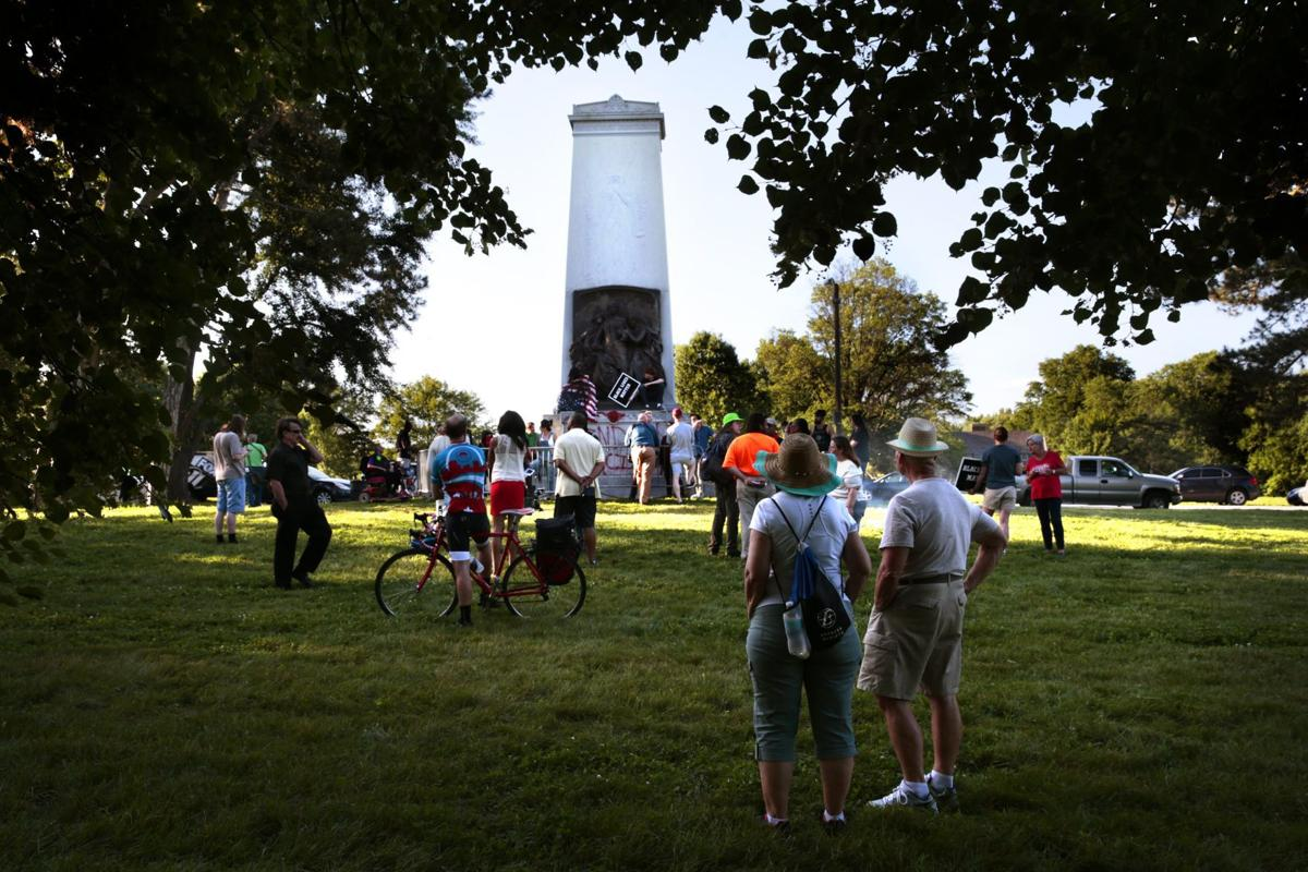 Protesters square off at Confederate monument in Forest Park