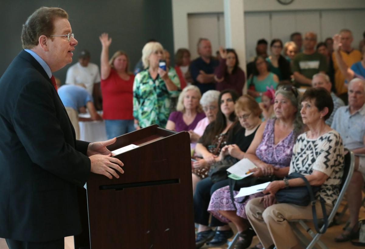 Zimmerman takes questions at town hall meeting addressing rising property values