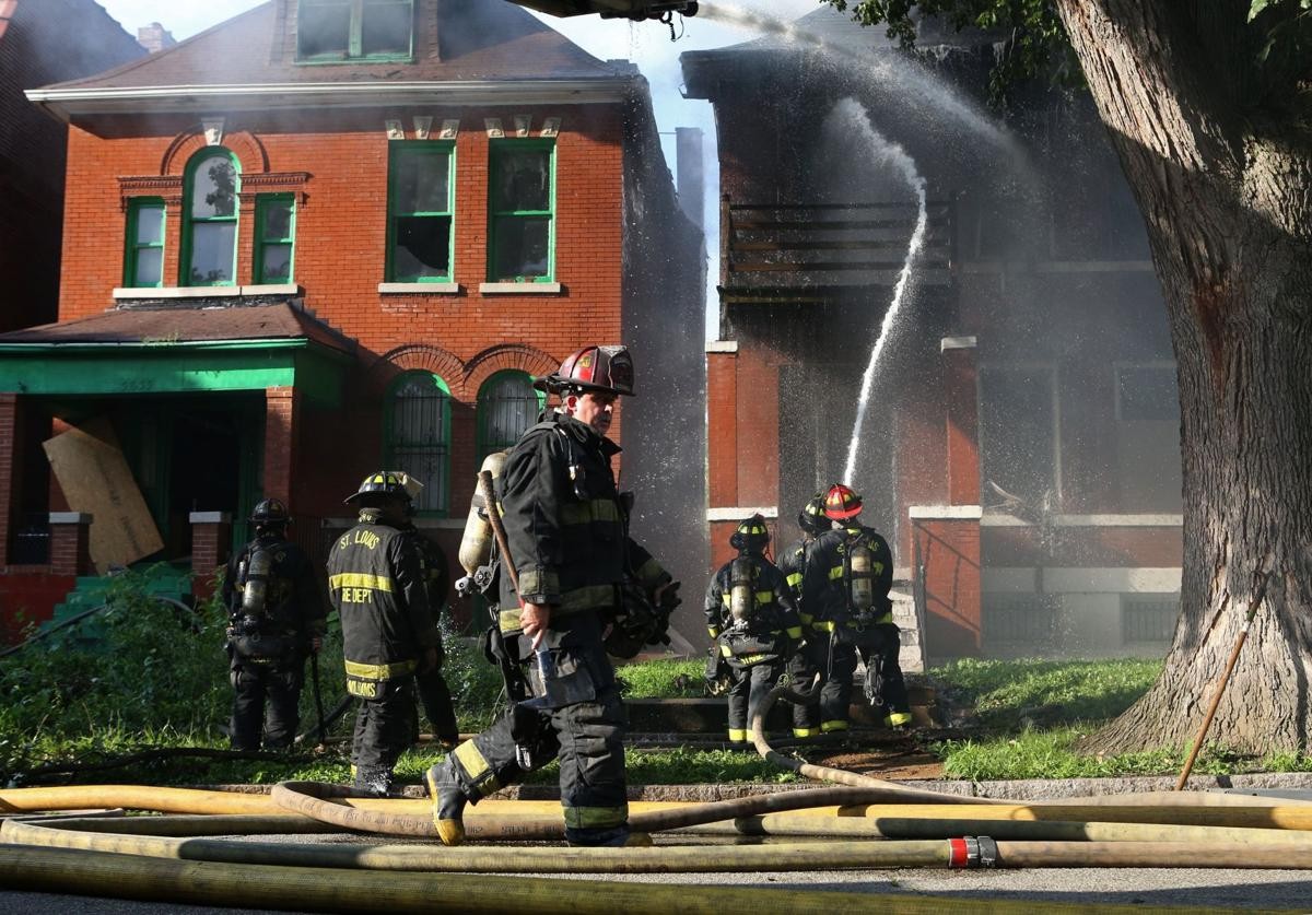 Fire in home spreads to two others