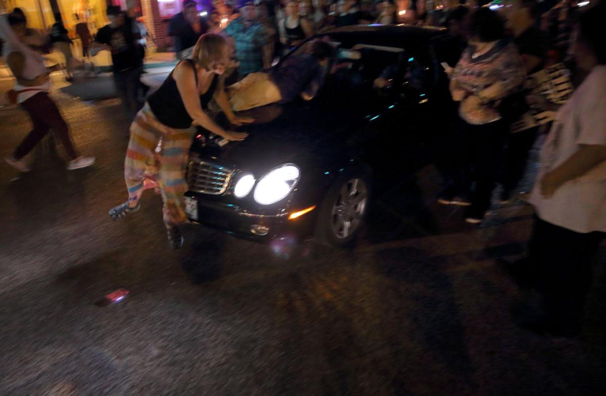 Car drives through protesters in St. Louis