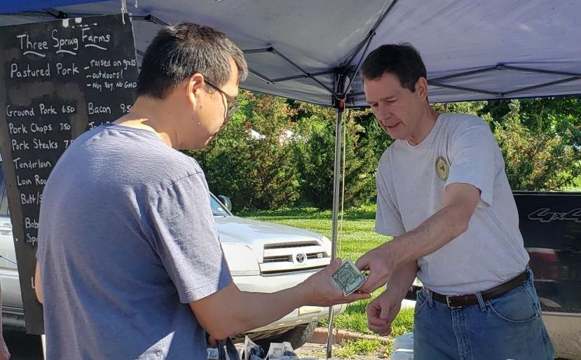 Dr. Bryan Meyers, left, selling to Geoff Uy