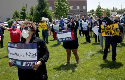Demonstrators urge lawmakers to support Medicare expansion