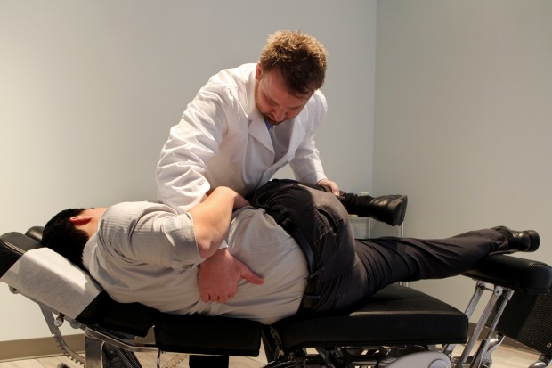 Dr. Terence Crowley performs therapy on a patient