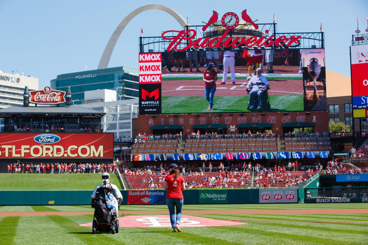 Paralyzed former Hazelwood Officer Craig Tudor and his wife throw out first pitch at Cardinals game