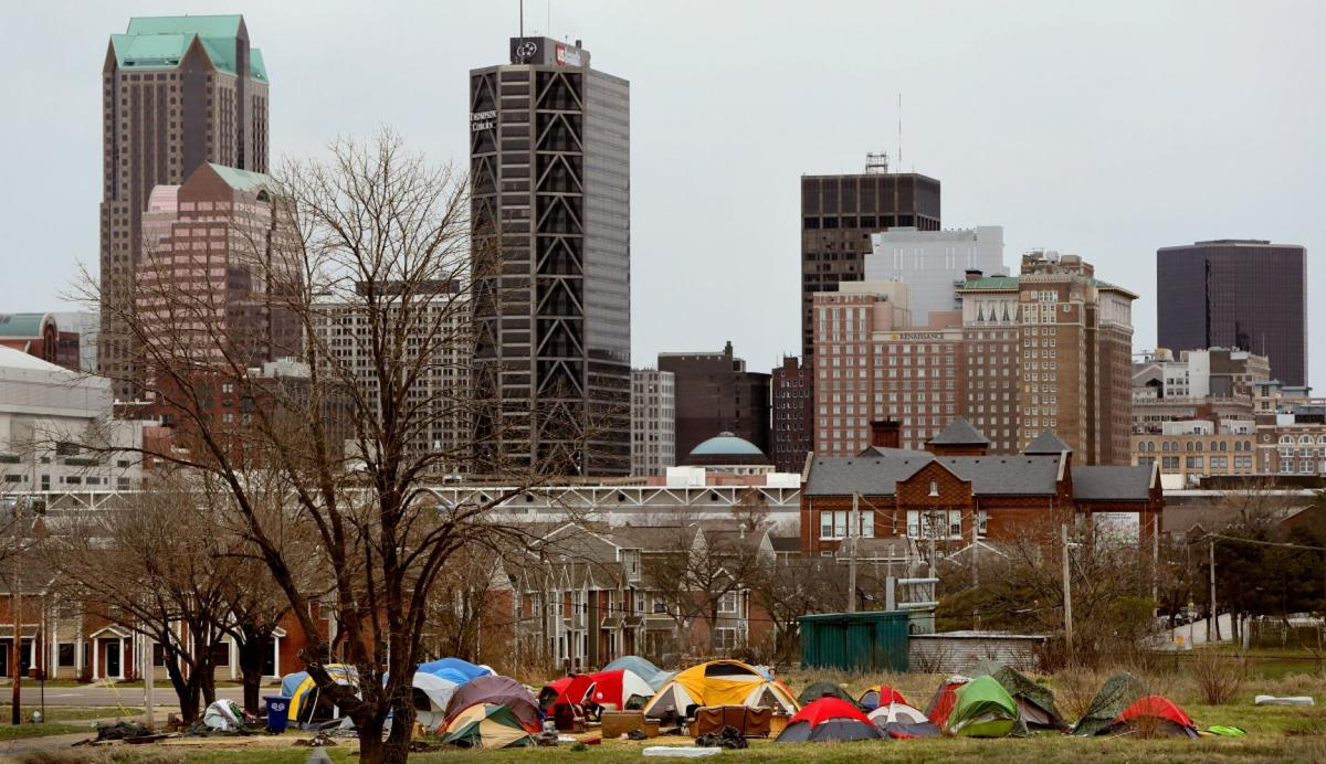Tent camp for homeless paints St. Louis skyline