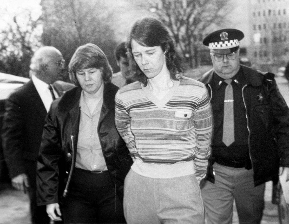 Paula Sims escorted into court in 1990
