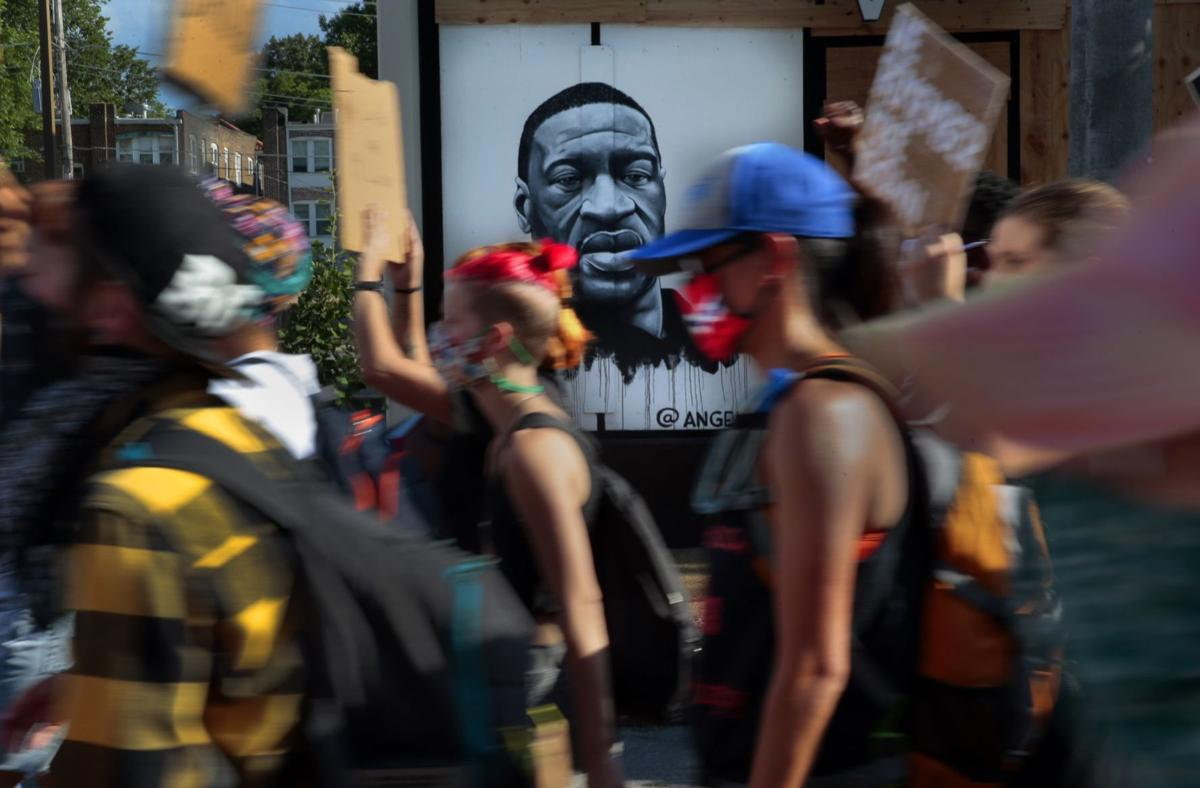 Protesters march through the Delmar Loop