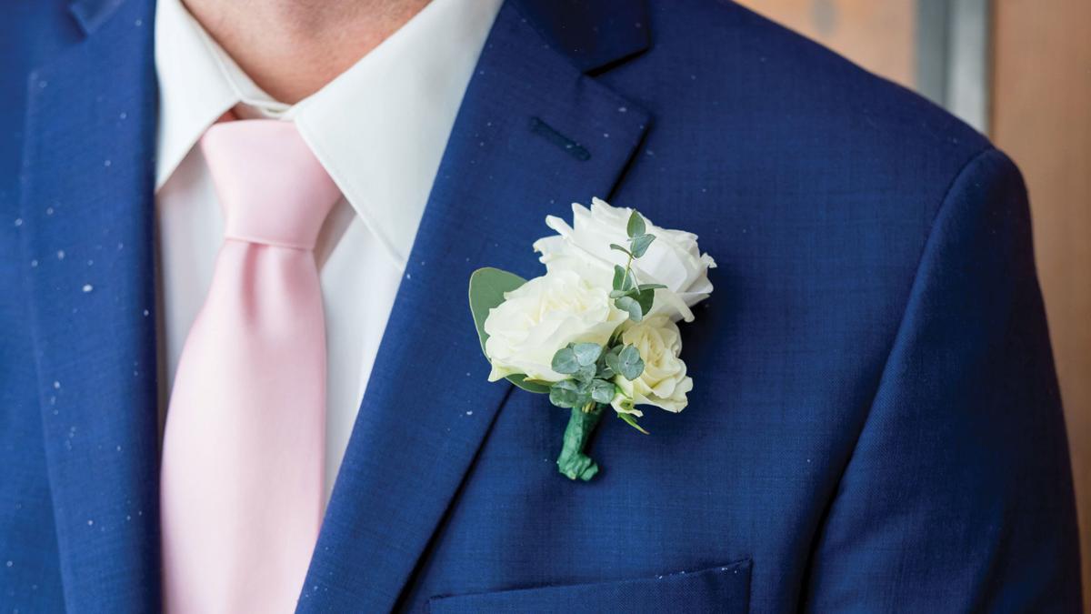 Blue suit, pink tie