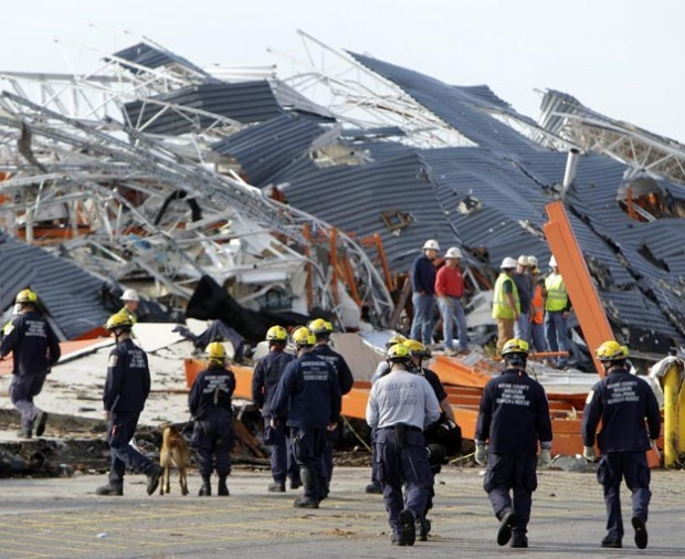 Search and rescue workers approach destroyed Home Depot in Joplin