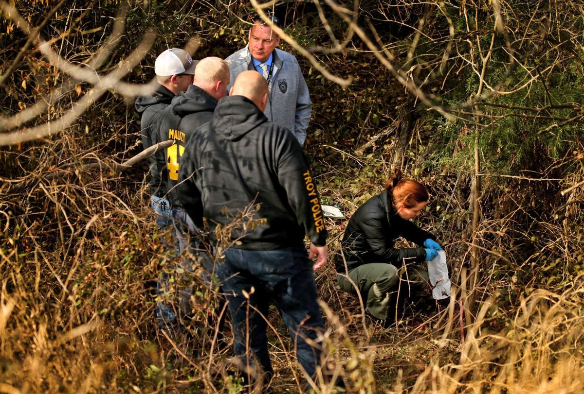 Police collect evidence in daylight where body of missing St. Louis County woman found