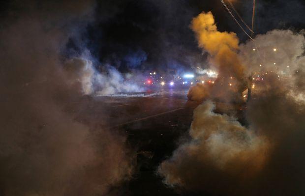 Police tear gas protesters again