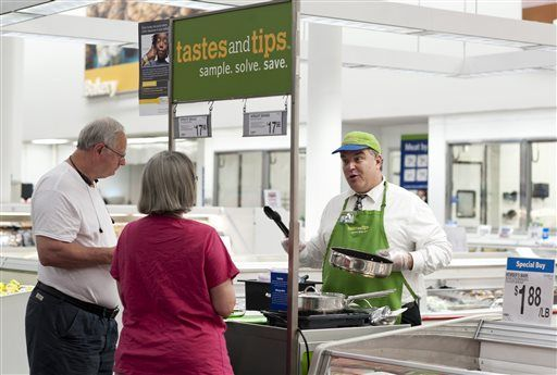 in this june 5 2014 file photo rick patanella right offers bacon samples to karla and gary owens at sams club in bentonville ark where parent