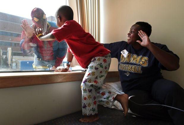 Spider-Men wipe 'em clean at Children's Hospital