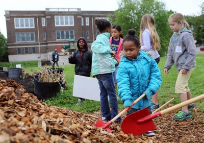 Clay and Avery Elementary students garden together with Gateway Greening