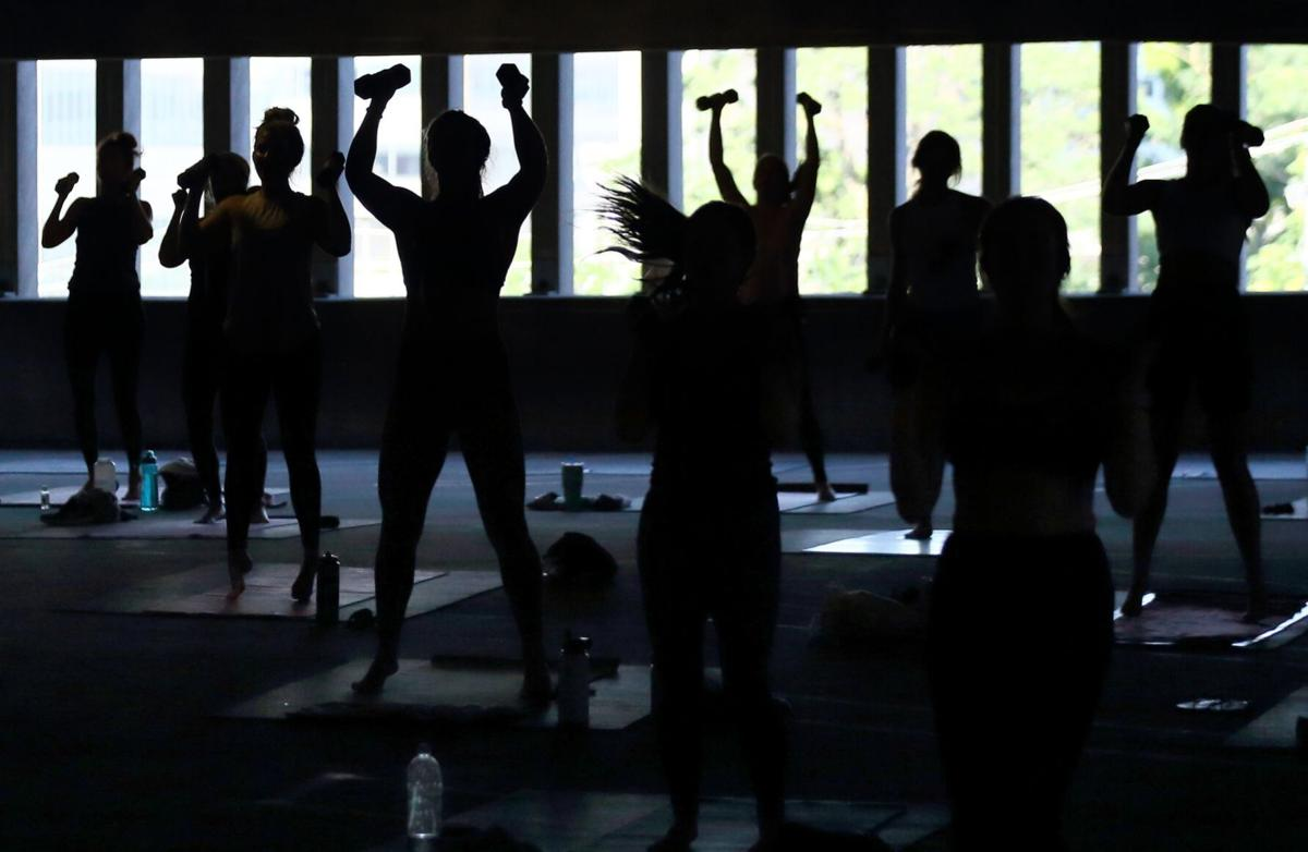 Fitness class held in parking garage during COVID-19 pandemic