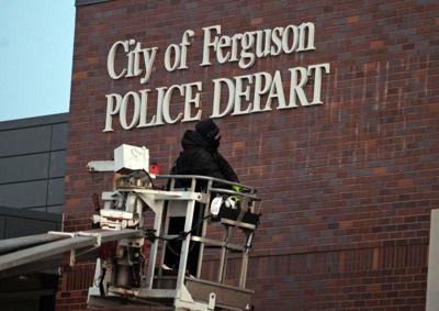 Signs go up at new Ferguson police station