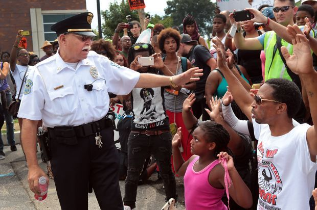 Protesters rally in front of Ferguson police station
