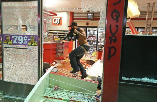 Looting at Ferguson store near vigil | Law and order | stltoday com