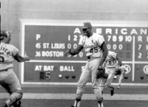 Bob Gibson celebrates the 1967 World Series victory