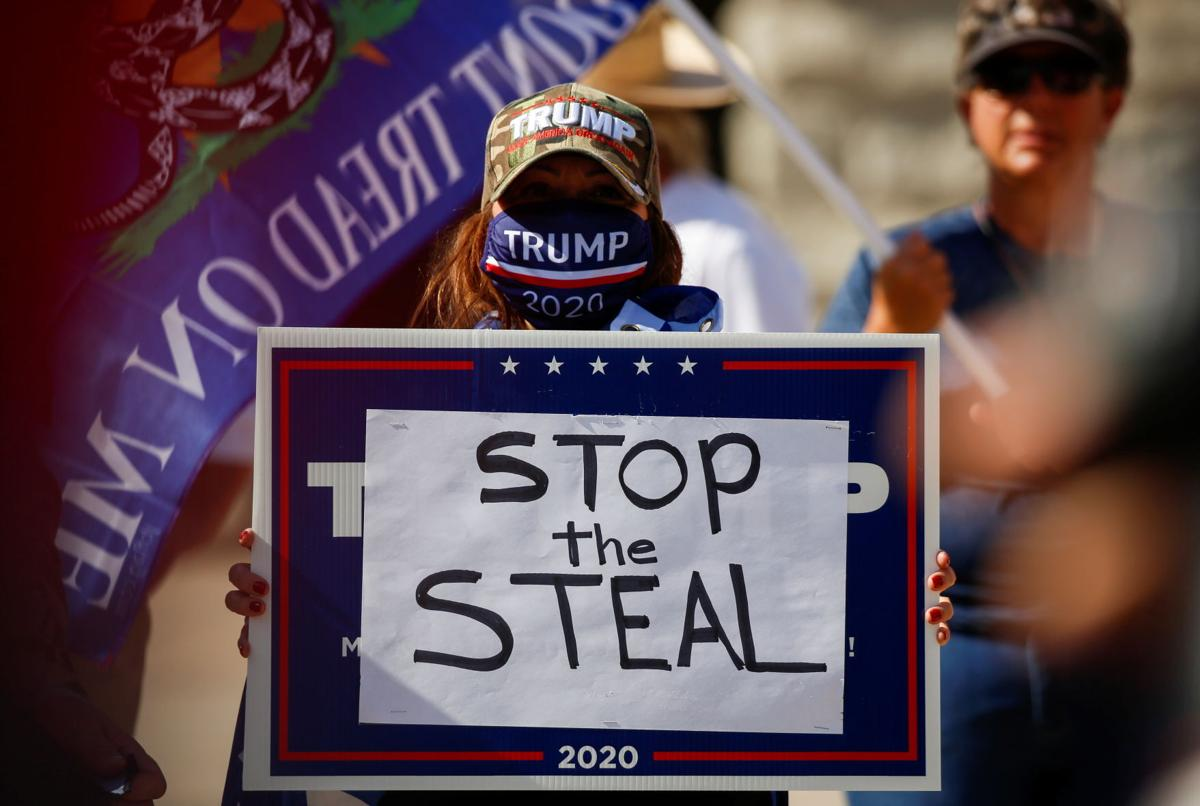 """Supporters of U.S. President Donald Trump gather at a """"Stop the Steal"""" protest after the 2020 U.S. presidential election was called by the media for Democratic candidate Joe Biden, in Phoenix"""