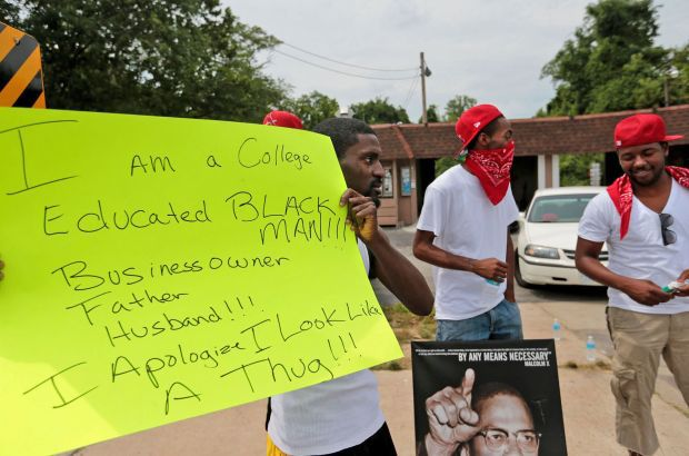 Bruce Franks, Jr. protests days after Michael Brown was fatally shot by a Ferguson police officer