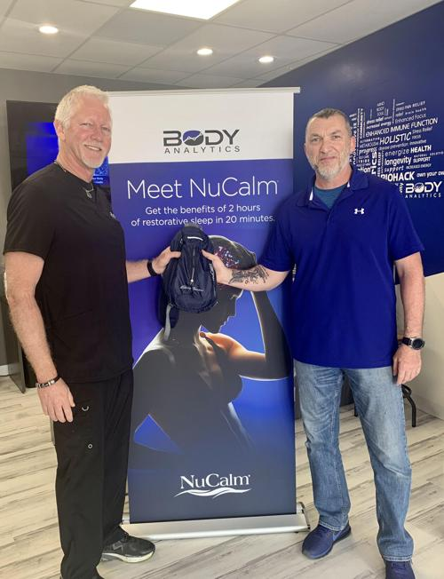 Johnny Harper of Body Analytics in St Louis presents gifted NuCalm stress-relief system to local veteran Sven Hunt