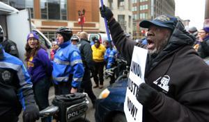 Janitors承可能なストライキが徒歩行のセントルイス大ビル