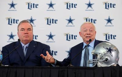 Dallas Cowboys head coach Mike McCarthy, left, and owner Jerry Jones talk with the media during a news conference at the Ford Center at The Star in Frisco, Texas, on Wednesday, Jan. 8, 2020. McCarthy has added four more coaches so far.