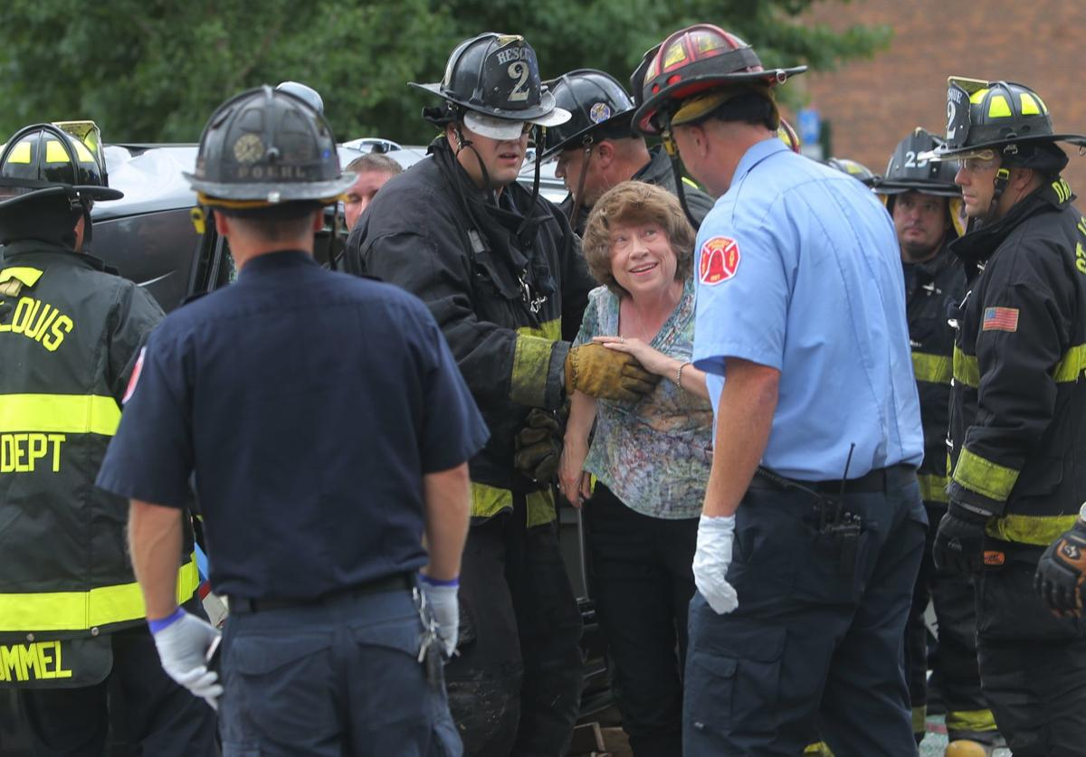 Photos: Firemen rescue people from overturned car in Forest Park