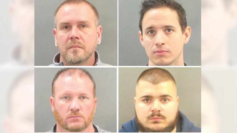 Four officers charged with stealing overtime pay