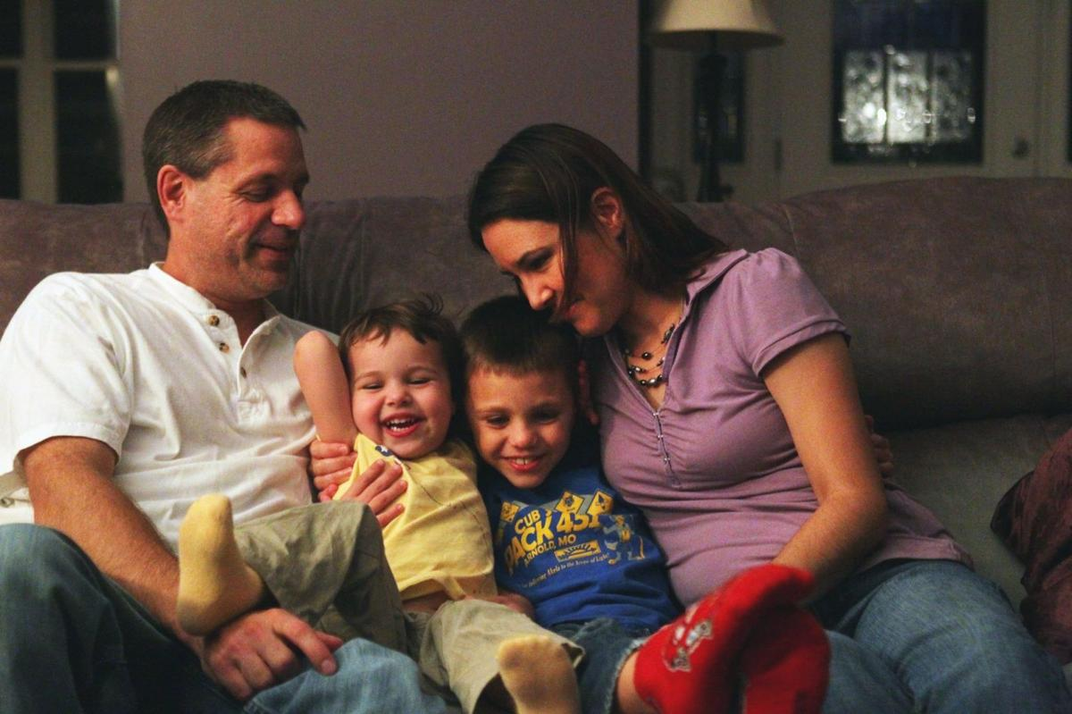 Steve and Shelley Blecha sit with their kids Clayton, 8, and Riley, 3, at their home in Imperial.