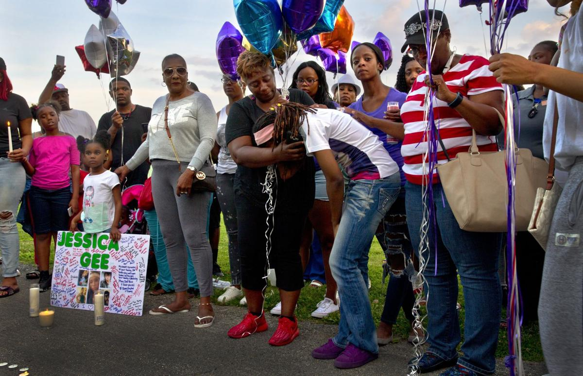 Vigil held for victims of triple fatal shooting, wounded 7-year-old later dies