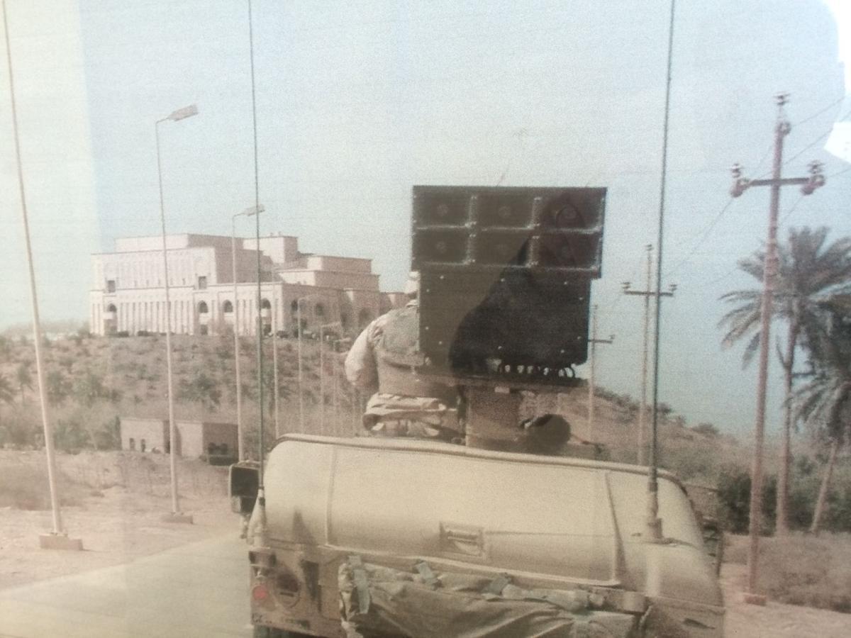 SOH Dixon, photo shows a PSYOP Humvee with loudspeaker heading toward Saddam's palace.JPG