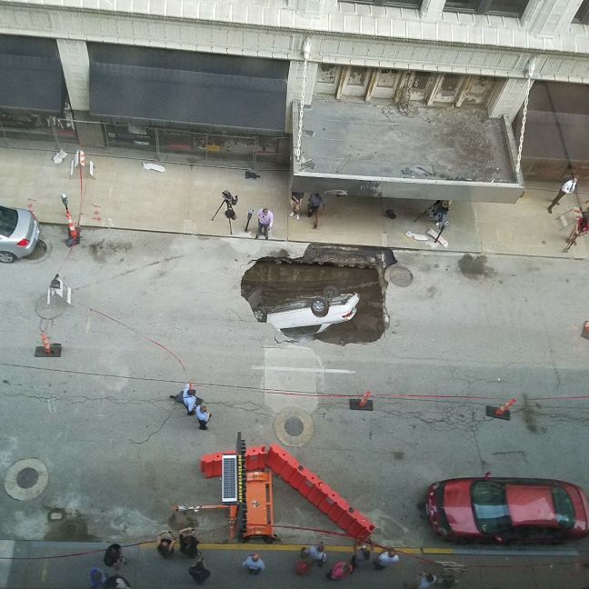 Sinkhole swallows Camry in downtown St. Louis
