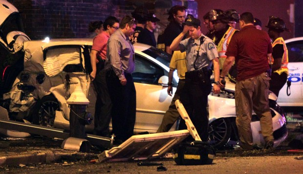 Officer, two others hurt in collision