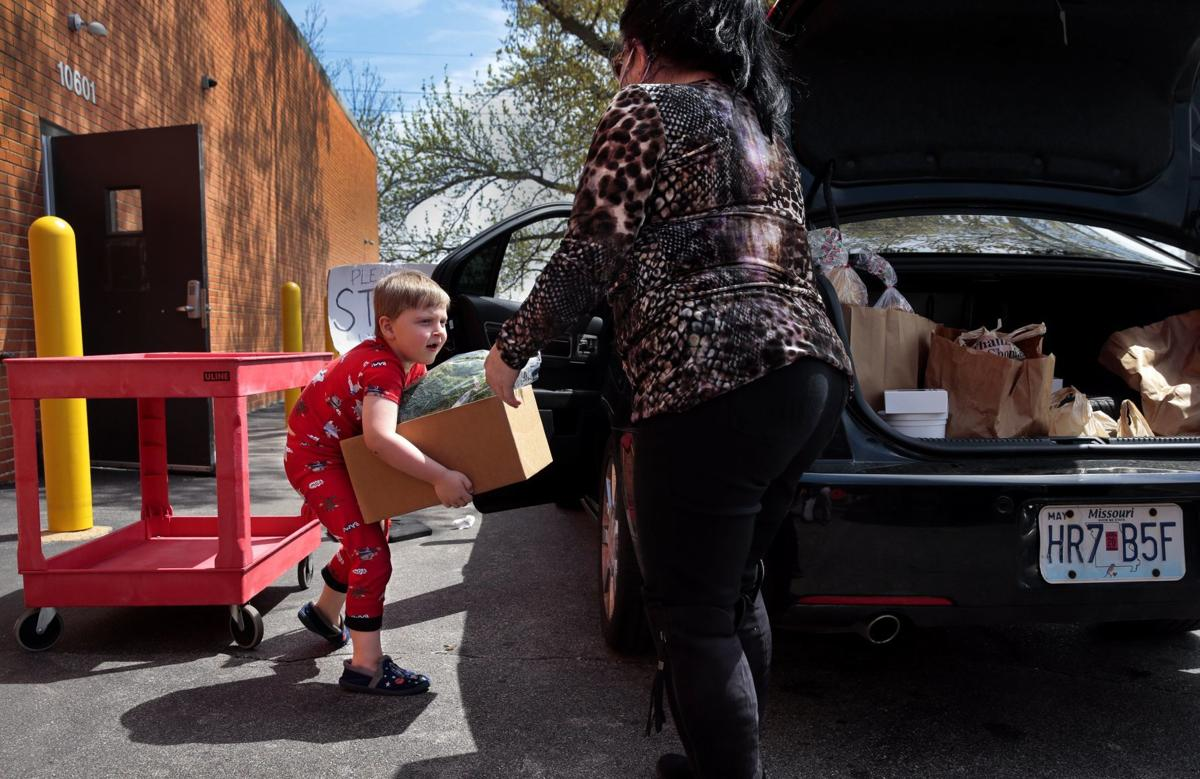 Food pantries work to serve families safely with rise in demand