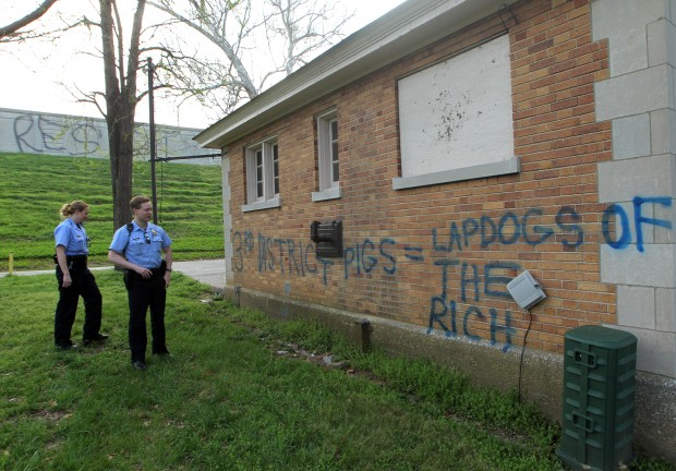 Vandalism at Compton Hill Reservoir Park- St. Louis Police Officers survey vandalism