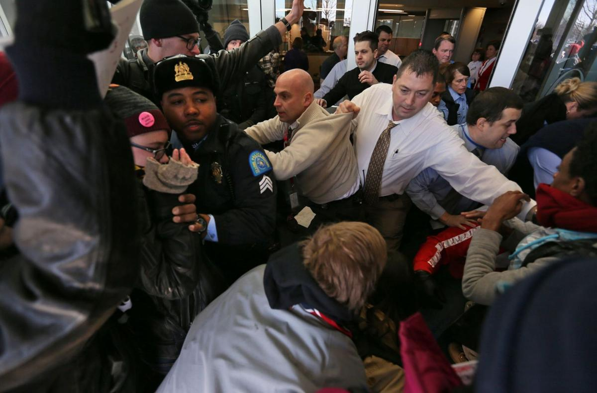 Police block protesters from rushing into St. Louis Police HQ