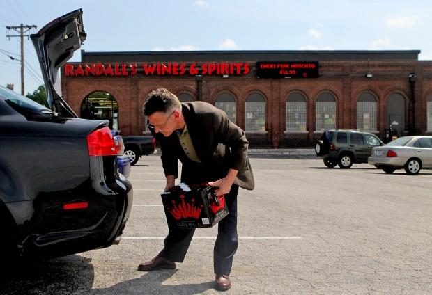 Dr. Rob Bernardi puts Bud Select into his trunk