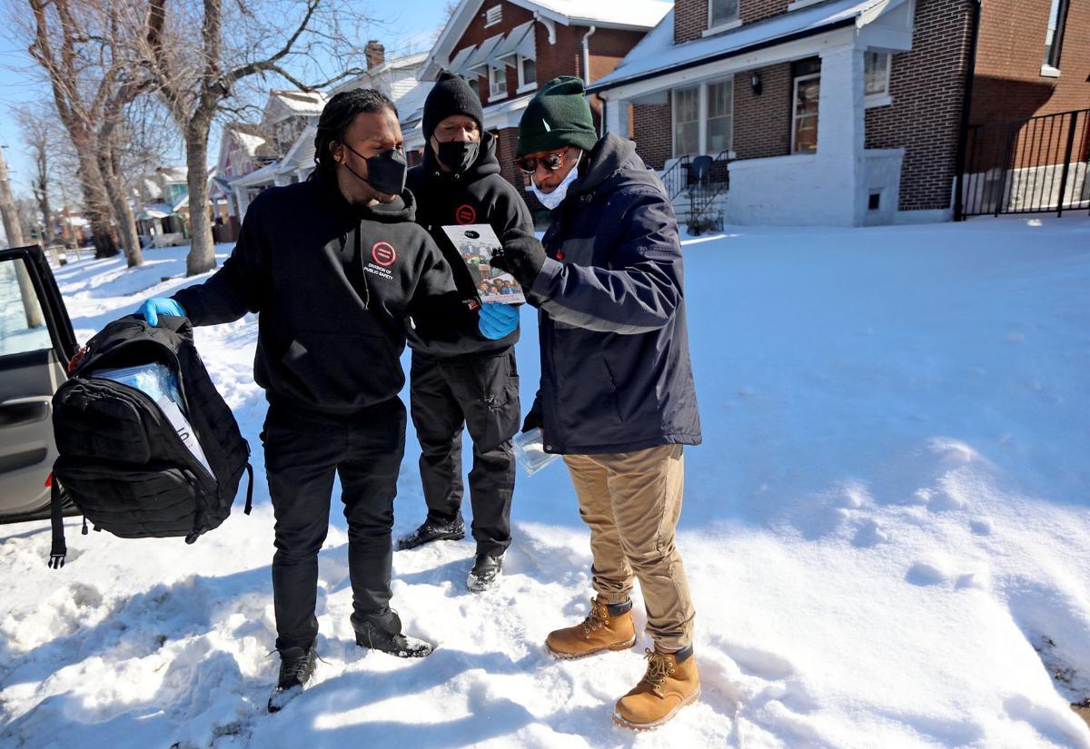 Urban League ourtreach workers distrbute PPE