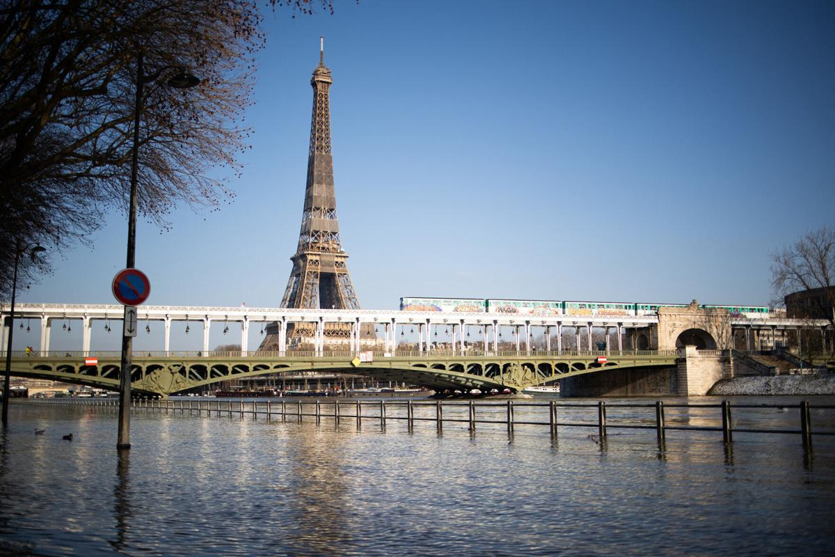 It could be a while before Americans get to take in this view of the Seine with the Eiffel Tower in person.