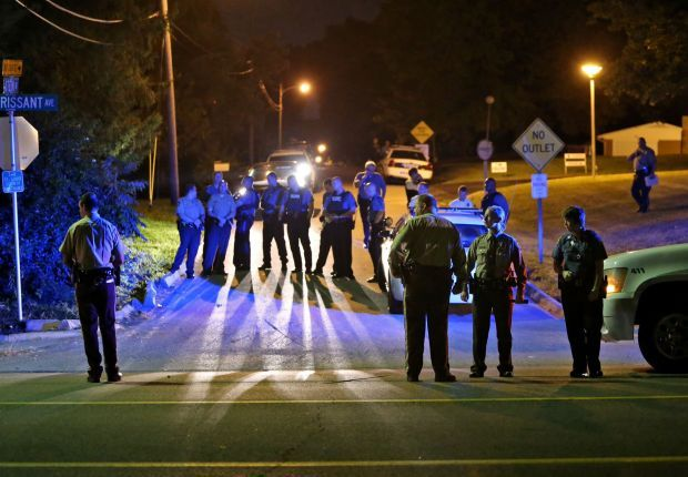 Ferguson police officer shot in the arm