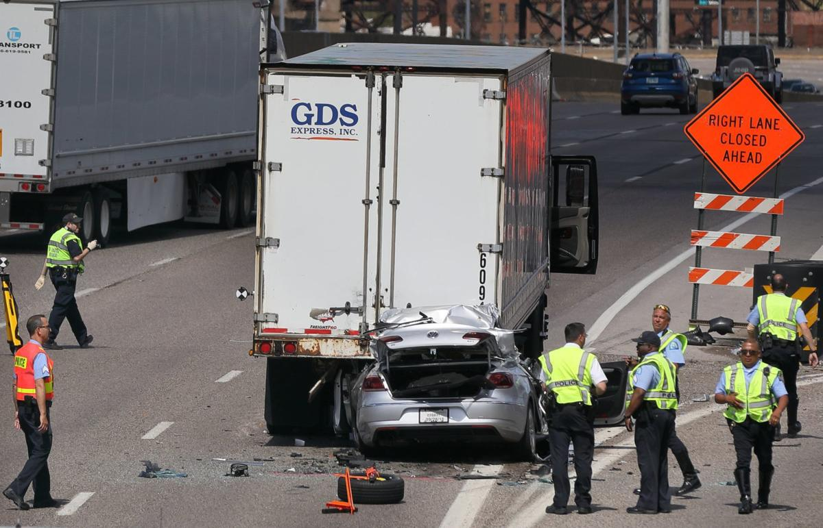 Two dead after car crashes into back of stopped truck on Interstate