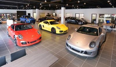 houston company buys another st. louis porsche dealership | building